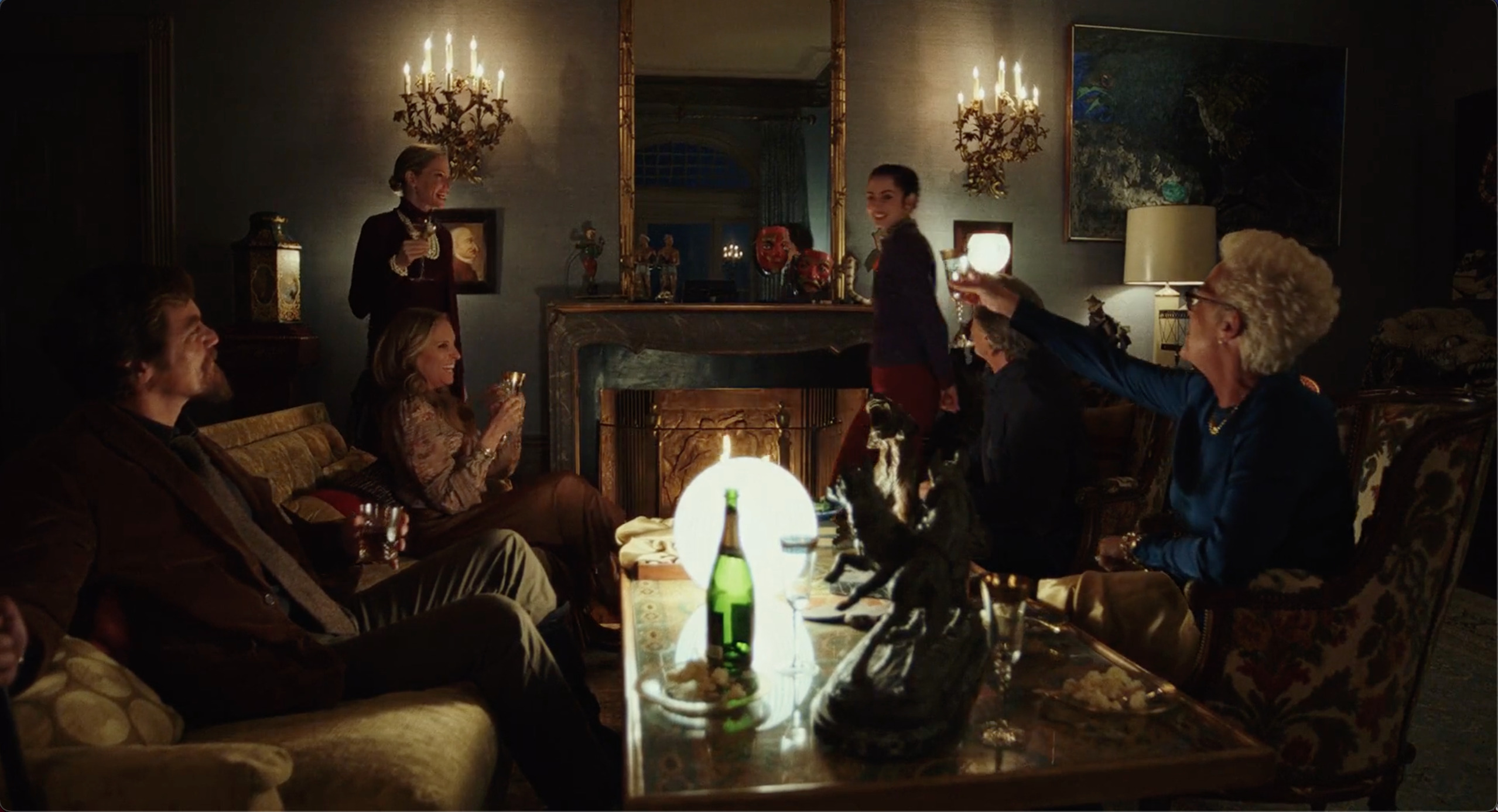 5 members of the Thrombey family appear to raise their drinks to Marta.